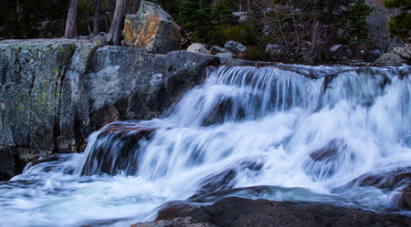 rapidly: White frothing water as it flows rapidly downward.
