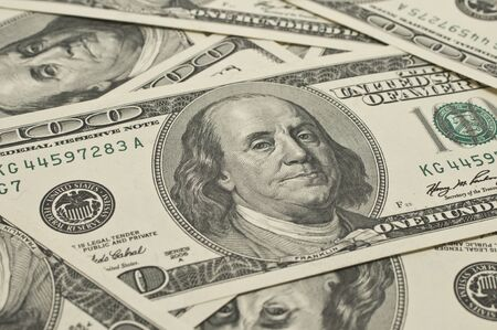 U.S. dollars are scattered on the table