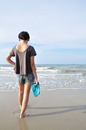 beautiful young asian woman on the beach photo