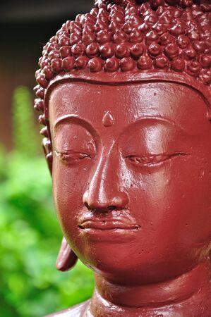 Red buddha statue photo