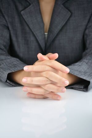 A business man with an clasp hand to contemplate photo