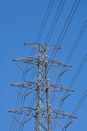 Electrical tower in field under blue sky Stock Photo - 11281622