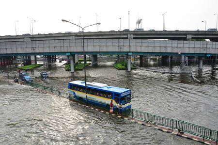 BANGKOK, THAILAND - NOVEMBER 05 : Heavy flooding from monsoon rain in Ayutthaya and north Thailand arriving in Bangkok on November 05,2011 Bangkok, Thailand,At Ladprao junction,Paholyothin & Ladprao Rd.