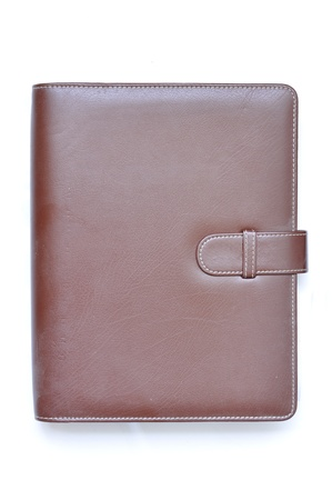 Leather organizer on white background photo