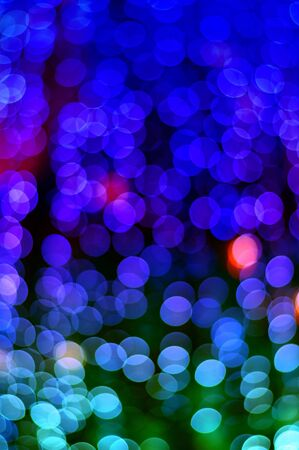 Color Bokeh against a dark background photo