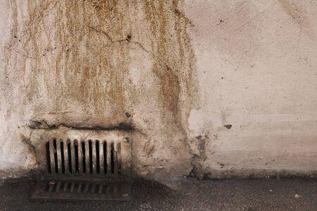 Closeup of old rusty dirty water drain