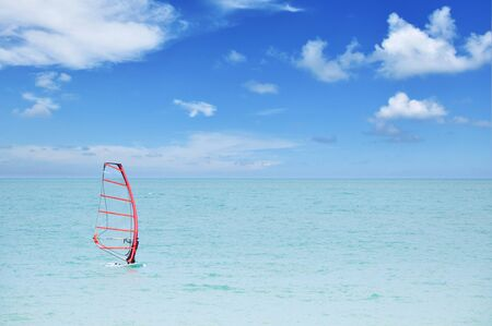Unrecognizable person practicing windsurf photo