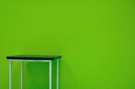 Table on green wall photo