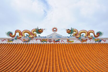chinese temple: Statue of twin dragons on the roof of Chinese temple Stock Photo