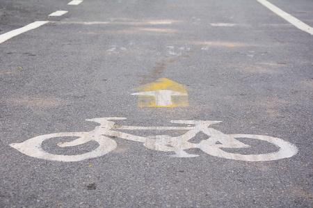 Bicycle symbol on city street photo