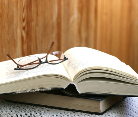 thick open book and glasses photo