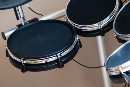 Electronic drum set closeup as musical background technology theme side view Stock fotó