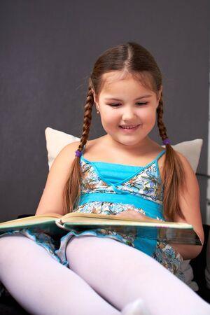 Little girl reading.