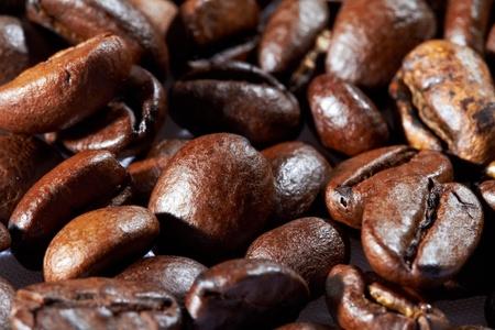 Pile of roasted black coffee.