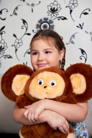 A little girl with a big plush toy. Stock Photo