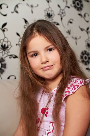 little girl sitting. Stock Photo