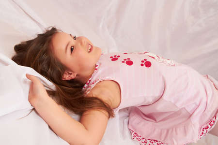 Girl lying on the floor and have fun. Stock Photo