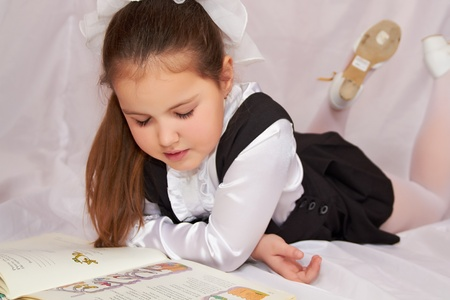 A child reading a book. photo