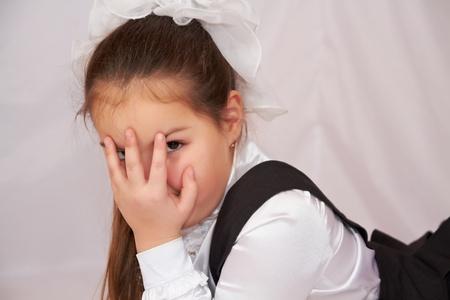 Kleines M�dchen in Schuluniform. Lizenzfreie Bilder