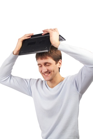image of a young man holding a laptop isolated on white Stock Photo