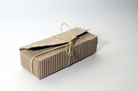 Vintage isolated carton giftbox over white background with retro style photo