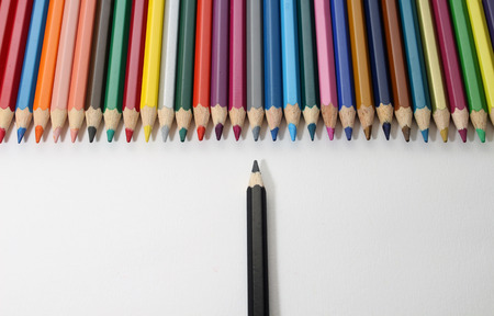 favor: Isolated colored pencils with white background shows opposite between malignity and favor or shows discrimination