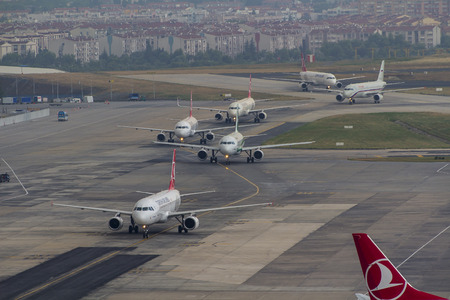 departing: airport operations with push back landing departing taxiing over apron runway and taxiway 18062015 Istanbul Turkey