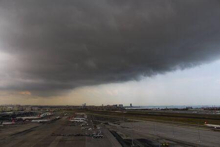 build up: airport operation under bad weather conditions dark clouds cb build up