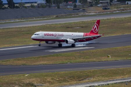 touch down: air plane landing on runway and drifting touch down 18062015 Istanbul  Turkey