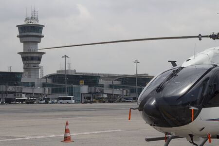 atc: close up helicopter and air traffic control tower with background in airport apron terminal 18062015 Istanbul  Turkey