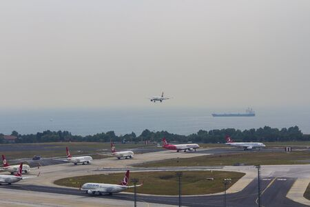 airport operations with push back landing departing taxiing over apron runway and taxiway 18062015 Istanbul Turkey