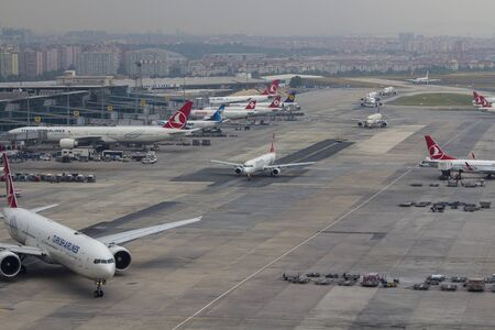 airport operations with push baairport operations with push back landing departing taxiing over apron runway and taxiway 18062015 Istanbul Turkey