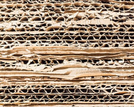 paperboard: stacked brown paperboard with asymmetryic pattern Stock Photo