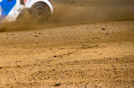 skidding: Rally car wheel and and ground floor with skidding car Stock Photo