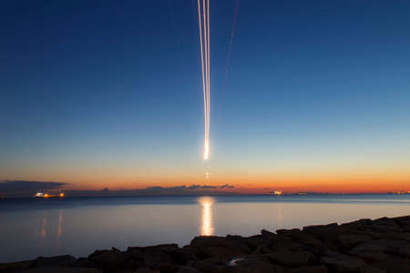 airplane landing: Long exposure airplane landing during the twilight