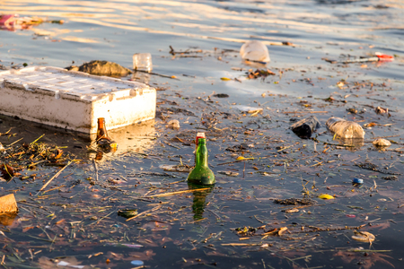 polluted river: Rubbish and bottles over the sea shows the sea pollution empty image for design