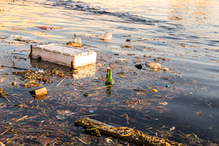 Rubbish and bottles over the sea shows the sea pollution empty image for design