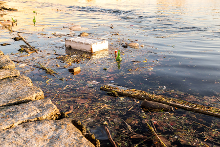 sea pollution: Rubbish and bottles over the sea shows the sea pollution empty image for design