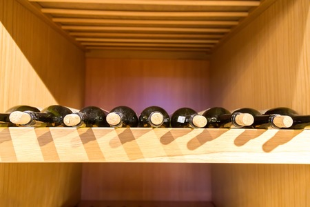 horizontal position: Wine bottles on the rack with horizontal position