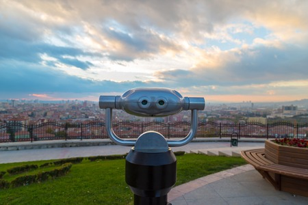 operated: Coin operated binocular with city view and cloud