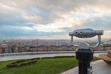 monocular: Coin operated binocular with city view and cloud