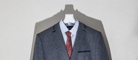 vibrance: Suit Dummy with vintage clothes and reduced vibrance image for any retro effect and its shadow