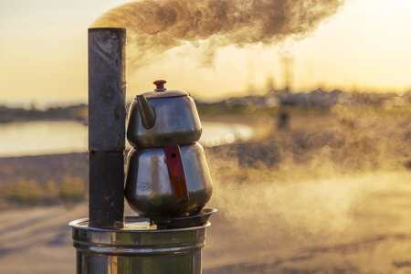 urn: Traditional Turkish Tea Urn near the sea during the sunset Stock Photo