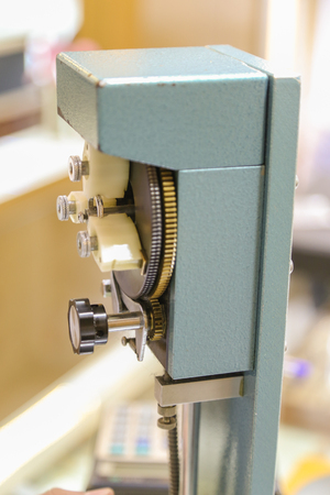 article writing: Manuel gravograph machine that performs writing article or number onto the jevellery, shallow depth of field image
