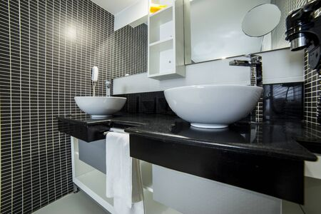 master bath: View of elegant bathroom with black tiles, wide angle lens image may use distraction