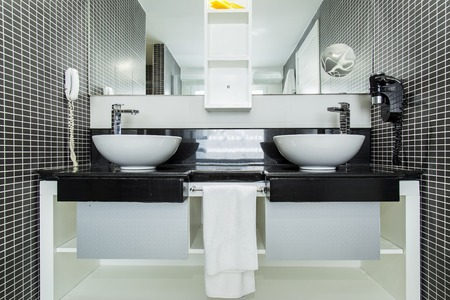 distraction: View of elegant bathroom with black tiles, wide angle lens image may use distraction