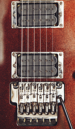 floyd: Electric guitar detail view, zoom in to floyd rose, very shallow depth of field image, cinematic effect applied Stock Photo