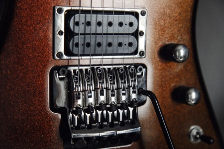 tremolo: Electric guitar detail view, zoom in to floyd rose, very shallow depth of field image, cinematic effect applied Stock Photo