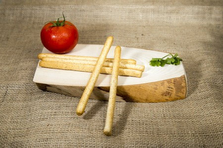 sesame cracker: Organic diet crackers over wooden tray and sackcloth, studio image