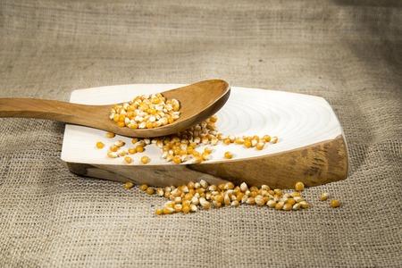 sackcloth: Organic corn over wooden tray and sackcloth, studio image